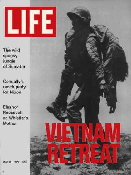 Life - Vietnam soldier carries wounded buddy