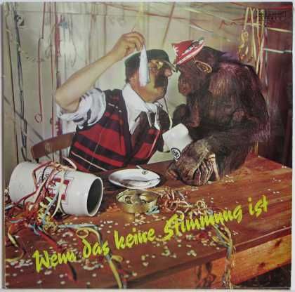 Oddest Album Covers - <<Man offers chimp herring after party>>