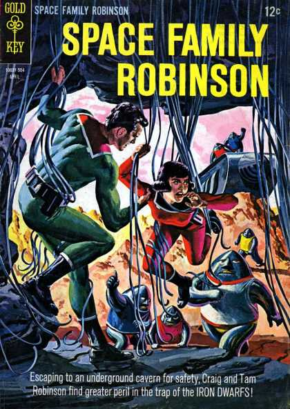 Space Family Robinson 12 - Man And Woman - Entangled In Wires - Escaping To An Underground Cavern For Safety - Craig And Tam Robinson Find Greater Peril - In The Trap Of The Iron Dwarfs